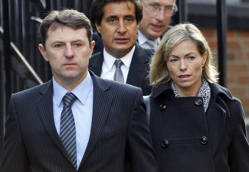 """FILE - In this Wednesday, Nov. 23, 2011 file photo, Gerry and Kate McCann arrive to testify at the Leveson inquiry at the Royal Courts of Justice in central London. A woman who was accused of sending Internet abuse to the parents of missing girl Madeleine McCann has been found dead in a hotel room in Leicester, central England, on Saturday Oct. 4, 2014. Her death has revived debate about media responsibility and how best to respond to online """"trolls."""" (AP Photo/Lefteris Pitarakis, File)"""