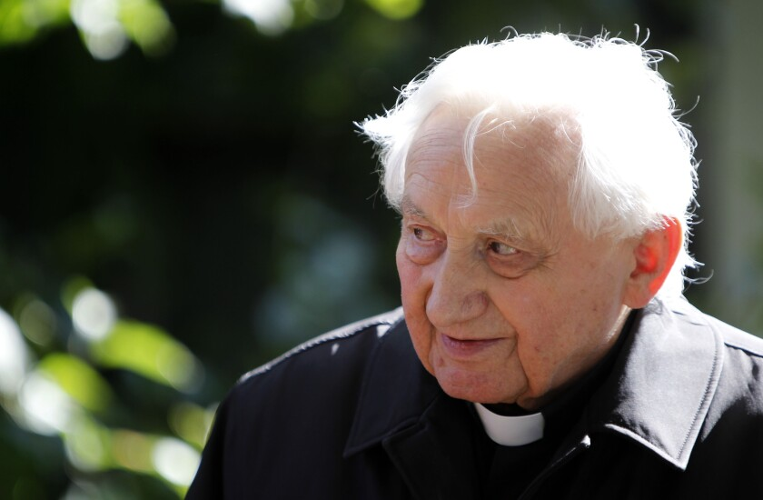 FILE - In this Thursday, Sept. 16, 2010 file photo, Georg Ratzinger attends a ceremony to hand over the keys of his house in Pentling near Regensburg, Germany. The Rev. Georg Ratzinger, the older brother of Emeritus Pope Benedict XVI, who earned renown in his own right as a director of an acclaimed German boys' choir, has died at age 96. The Regensburg diocese in Bavaria, where Ratzinger lived, said in a statement on his website that he died on Tuesday, June 30, 2020. (AP Photo/Matthias Schrader, File)