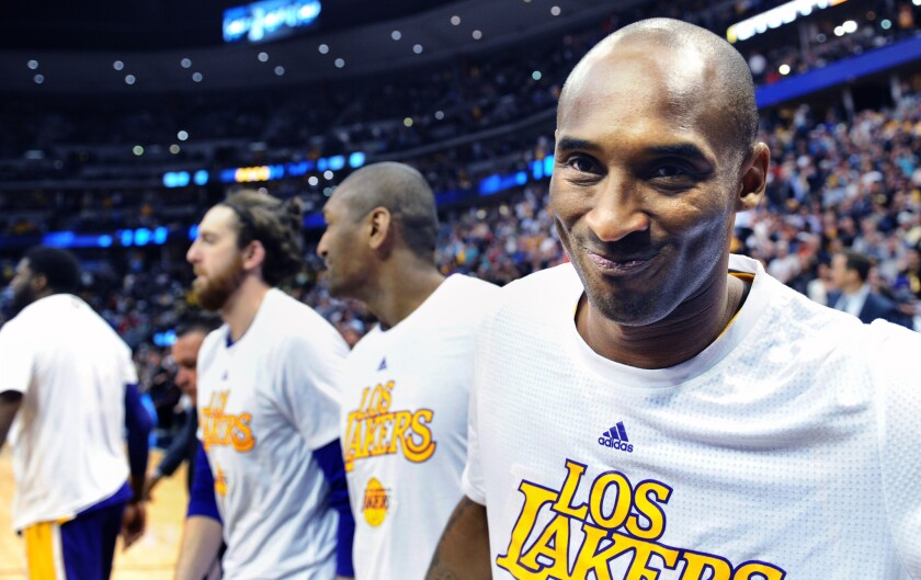 Kobe Bryant smiles as he leaves the court after his final game in Denver on March 2, 2016.