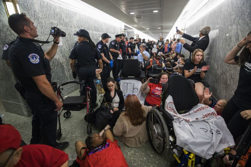 Protesters are removed from a Senate Finance Committee hearing on the Graham-Cassidy healthcare bill in Washington.