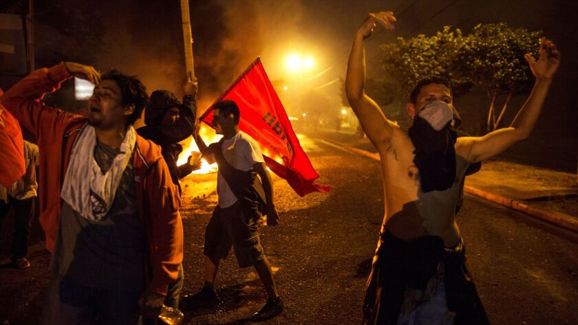 Supporters of presidential candidate Salvador Nasralla chant slogans against Honduran President Juan