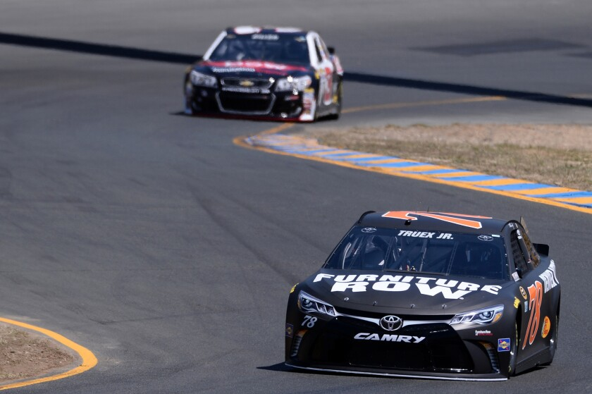 Martin Truex Jr., driver of the #78 Furniture Row Toyota, practices for the NASCAR Sprint Cup race at Sonoma Raceway.