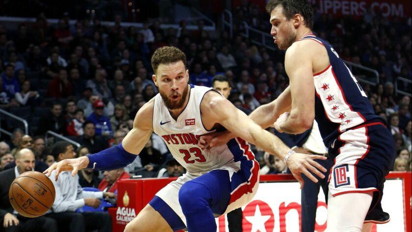 Detroit Pistons' Blake Griffin (23) dribbles against Los Angeles Clippers' Danilo Gallinari (8) duri