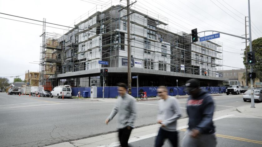 A state order will force cities in Southern California to plan for more and denser housing, such as this apartment complex under construction on Sawtelle Boulevard in Los Angeles in May.