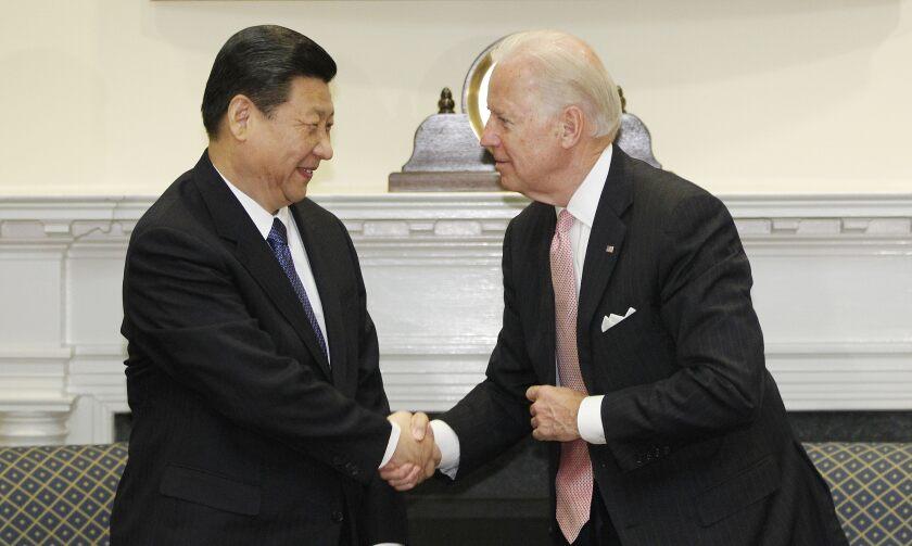Joe Biden and China's Xi Jinping shake hands