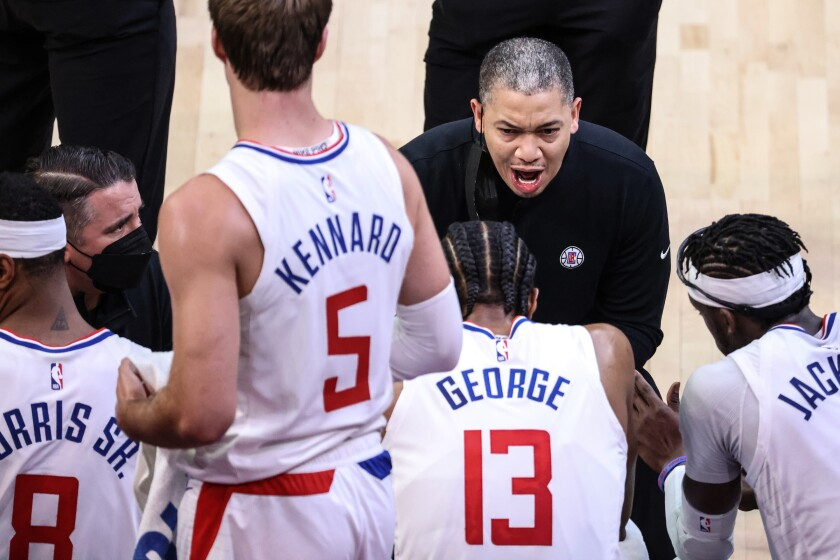 Clippers coach Tyronn Lue leads an animated huddle during Game 2.