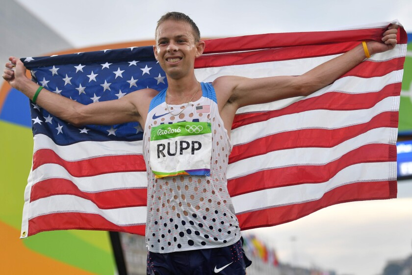 U.S. runner Galen Rupp celebrates after crossing the finish line and winning the bronze medal in the men's marathon on Aug. 21.