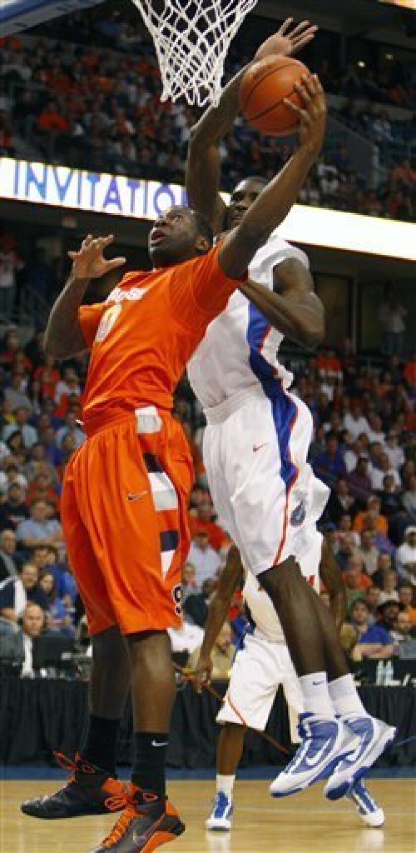 Syracuse forward Rick Jackson (0) goes to the basket in front of Florida's Vernon Macklin (32) during the first half of an NCAA college basketball game Thursday, Dec. 10, 2009, in Tampa, Fla. (AP Photo/Chris O'Meara)