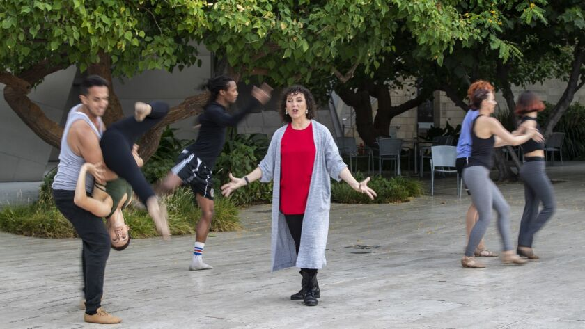 LOS ANGELES, CA - JULY 18, 2018: Choreographer and artist Janet Roston, center, as her dance company