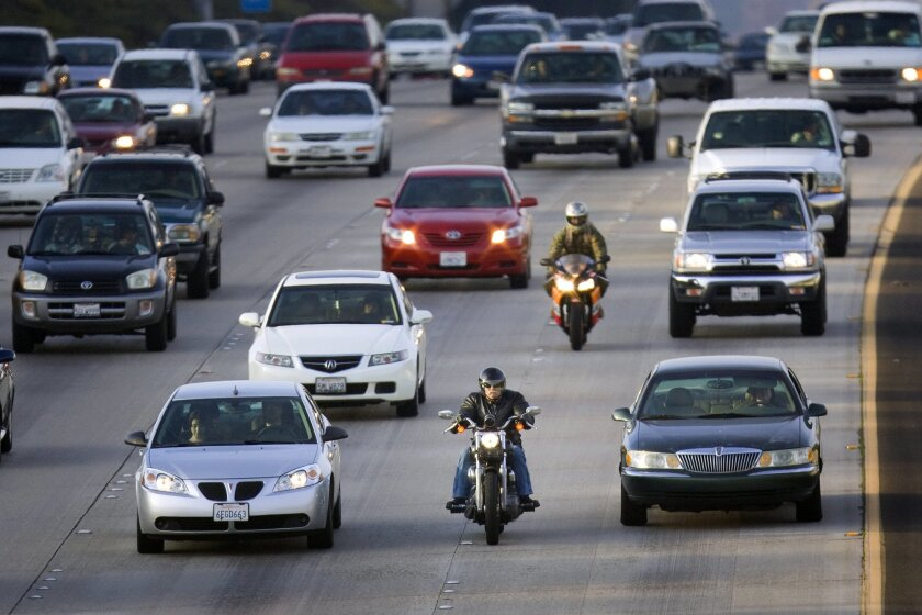 Traveling south on Interstate 805 yesterday, motorcyclists threaded between car lanes during the evening commute. Motorcyclists have welcomed the state's effort to look out for their safety.