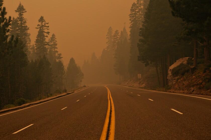 Smoke and ash hang over Highway 50