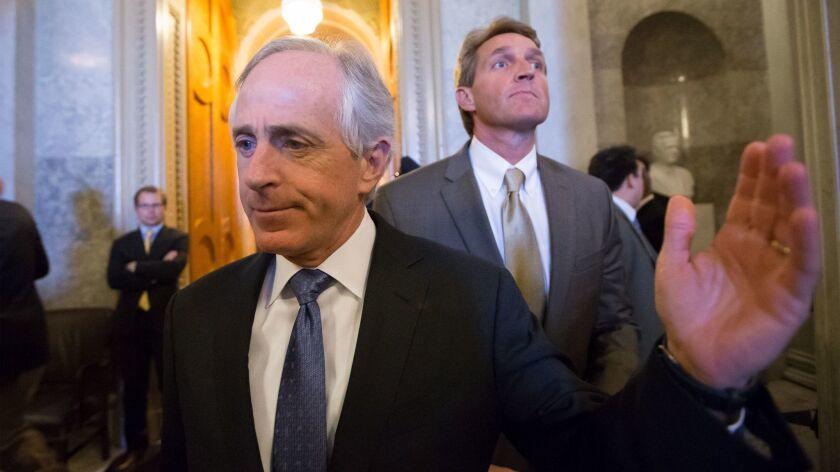 Sen. Bob Corker (R-Tenn.) and Sen. Jeff Flake (R-Ariz.) at the Capitol in Washington on Feb. 28, 2013.