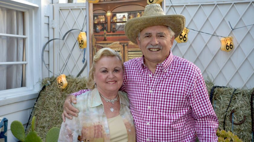 La Providencia Guild past-President Joan Chandler and Chris Gargaro ready for an evening of Western