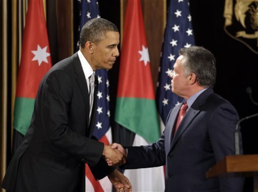 FILE - In this March 22, 2013, file photo, President Barack Obama, left, and Jordan's King Abdullah II, right, shake hands following their joint new conference at the King's Palace in Amman, Jordan. When Obama meets over the next month with leaders from Mideast and other regional nations, he will have a timely opportunity to try to rally the Syrian opposition's main backers around a unified strategy to oust Syrian President Bashar Assad. Jordan, Turkey, Qatar and the United Arab Emirates _ whose