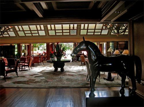 A wooden horse greets guests in the foyer of the Four Seasons Resort Lanai, the Lodge at Koele. Once a pineapple plantation, Lanai is now a luxurious  place to kick back and enjoy the Hawaiian island's natural beauty.