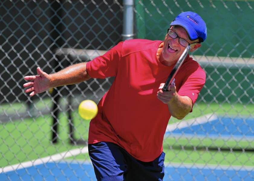 Pickleball champion Ford Roberson practices in Denton, Texas. The game has gone from its goofing off with the kids origins to a fast-growing sport that draws all ages.