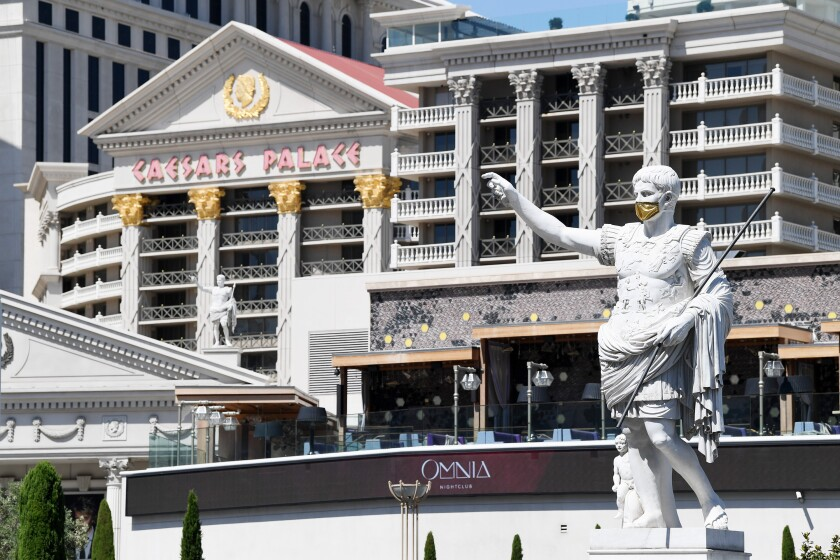 A masked Caesar welcomes guests to the hotel, which has rooms for less than $100 a night.