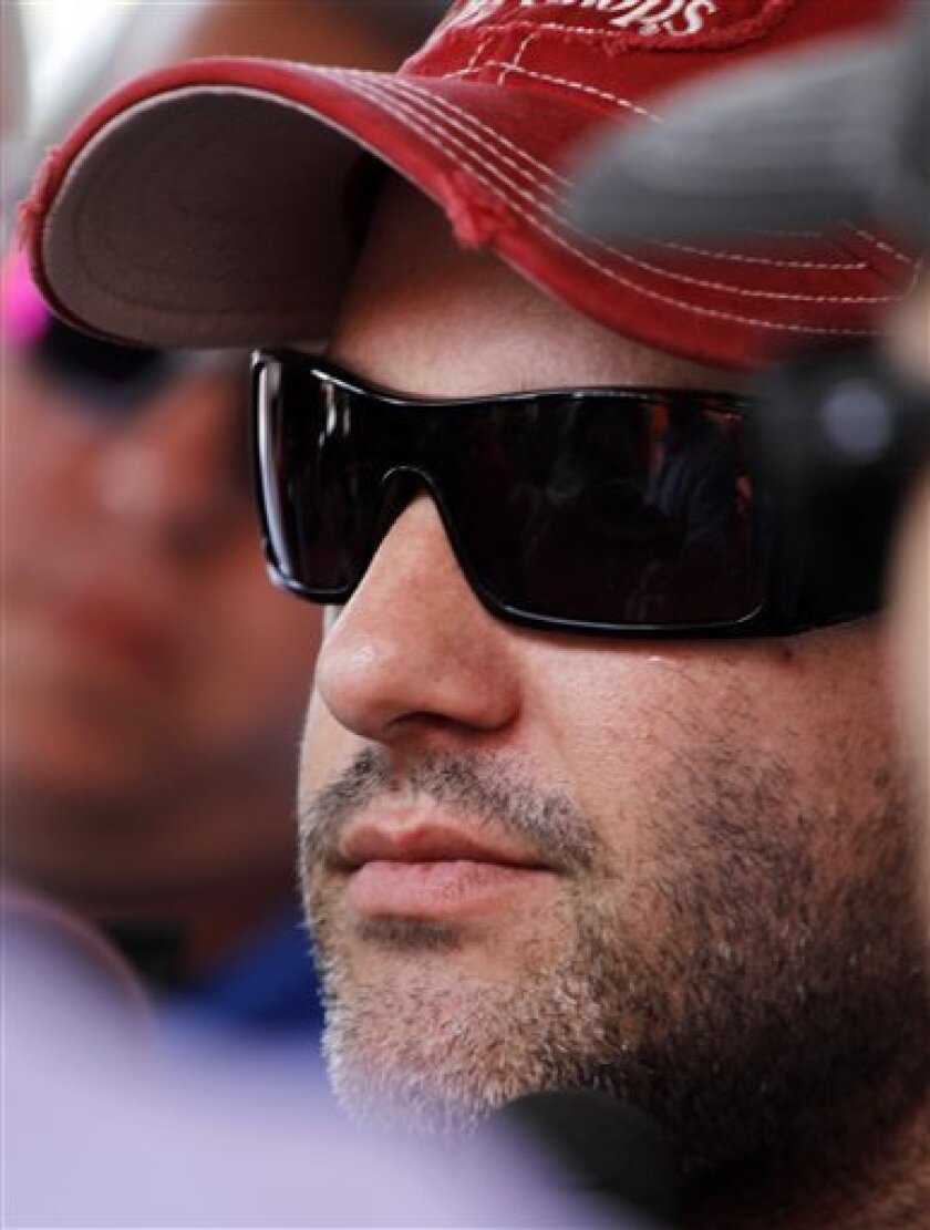 Tony Stewart answers questions from reporters after practice for the NASCAR Sprint Cup Series Irwin Tools Night Race auto race Friday, Aug. 26, 2011 in Bristol, Tenn. (AP Photo/Lisa Norman-Hudson)
