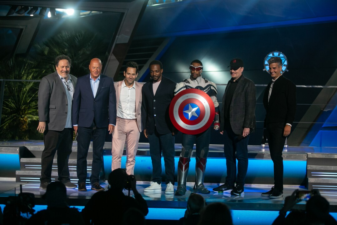 Jon Favreau, Paul Rudd and Anthony Mackie pose with the Captain America actor and Disney executives.