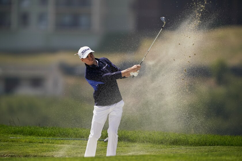 Justin Thomas hits from the bunker on the 16th hole during the third round of the PGA Championship golf tournament at TPC Harding Park Saturday, Aug. 8, 2020, in San Francisco. (AP Photo/Charlie Riedel)