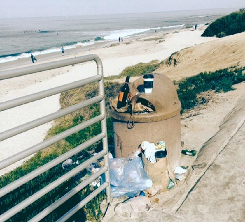 Trash cans by the beach at the corner of Palomar Avenue and Neptune Place in La Jolla are shown overflowing on Sunday, March 15, 2015.