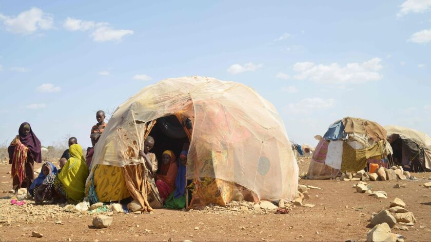 (FILES) This file photo taken on March 14, 2017 shows internally displaced families gathering in and
