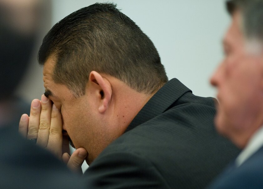 Former Fullerton Police Officer Manuel Ramos reacts after his acquittal in the beating death of a homeless man.