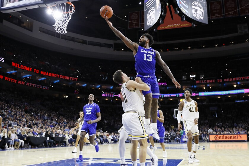 Seton Hall's Myles Powell (13) goes up for a shot against Villanova Collin Gillespie (2) during the second half of an NCAA college basketball game, Saturday, Feb. 8, 2020, in Philadelphia. (AP Photo/Matt Slocum)