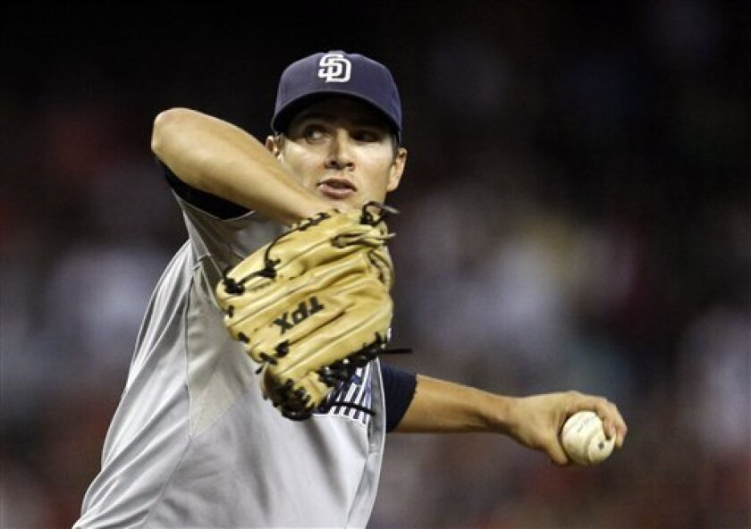 Padres' Cory Luebke throws against the Arizona Diamondbacks in the second inning on Aug. 28, 2011, in Phoenix.