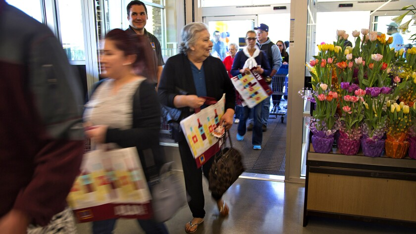 Early shoppers enter Aldi food market in Moreno Valley during the grand opening on Thursday.