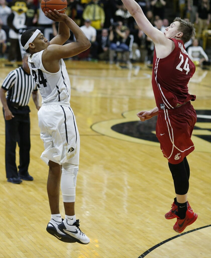 Colorado guard George King shoots a 3-pointer over Washington State forward Josh Hawkinson at the end of the first overtime, to tie the score in an NCAA college basketball game Thursday, Feb. 11, 2016, in Boulder, Colo. Colorado won 88-81 in double overtime. (AP Photo/David Zalubowski)