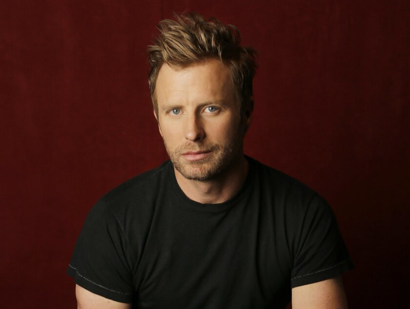 """In this May 17, 2016, photo, Dierks Bentley poses for a portrait in Nashville, Tenn., to promote his latest album, """"Black,"""" which comes out Friday, May, 27. (AP Photo/Mark Humphrey)"""