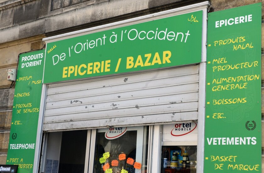 A Muslim-owned grocery store in the Saint-Michel neighborhood of Bordeaux on June 22. The shop sparked controversy by having affixed to its window a placard indicating separate opening days for men and women, a decision that was judged illegal and discriminating by local authorities.