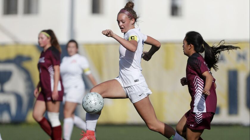 Pacifica Christian Orange County High's Sadie Hill, center, competes against Alhambra Mark Keppel du