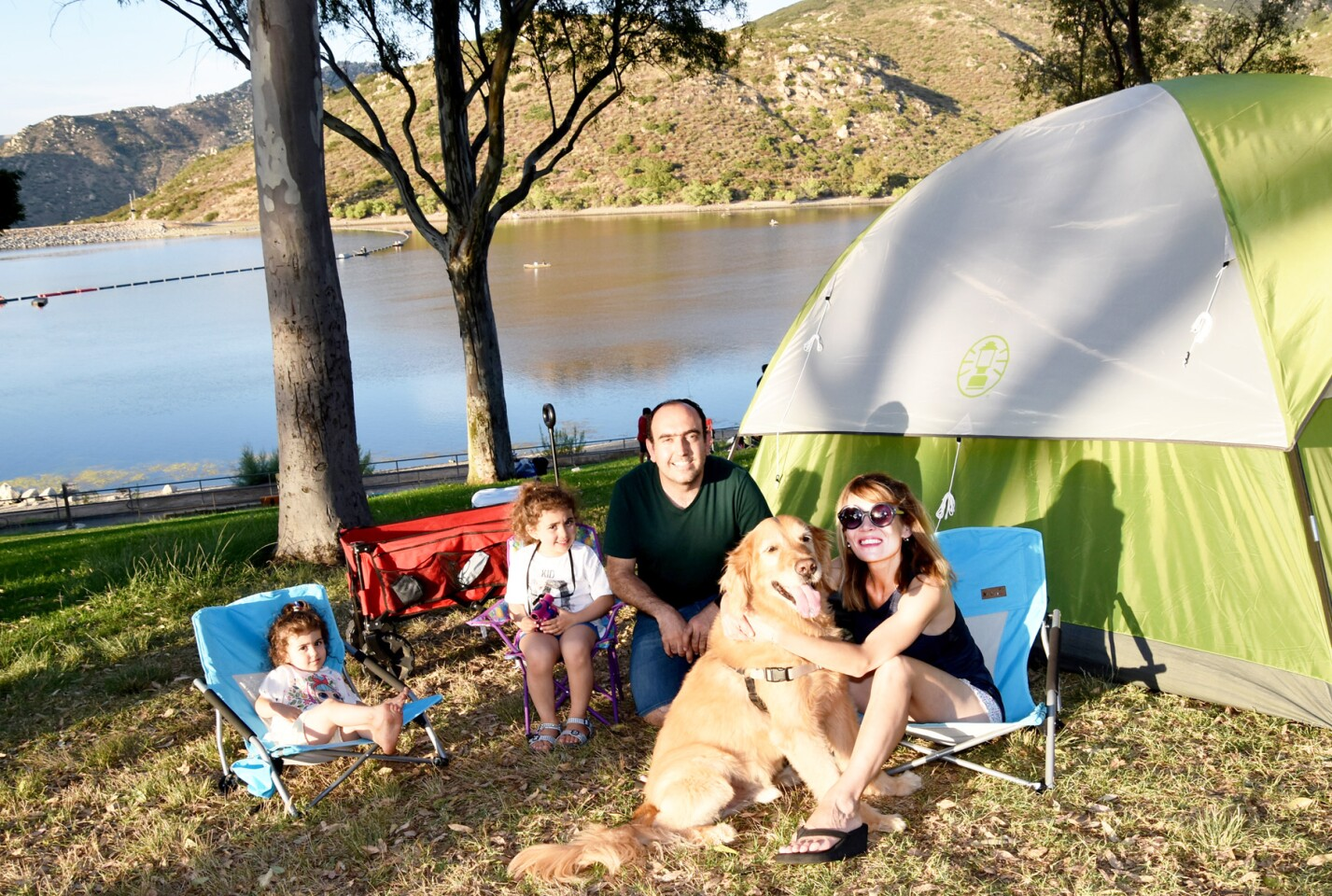 The Kayalar family ready for their campout — Marla Liv and Mona Rae with their parents, Alihanpolat and Dee, plus dog, Monty.