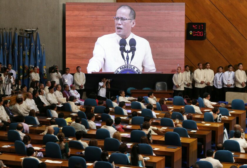 Philippine President Benigno Aquino III's image is shown on an electronic board as he delivers his last State of the Nation Address during the joint session of the 16th Congress at the House of Representatives in suburban Quezon city, north of Manila, Philippines on Monday, July 27, 2015. (AP Photo/Aaron Favila)