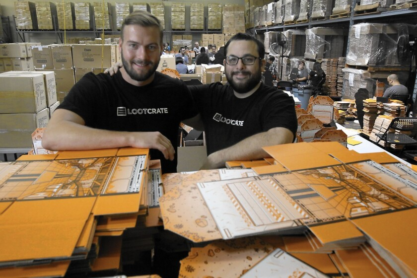 Chris Davis, left, and Matthew Arevalo are co-founders of Loot Crate, a 2-year-old company that for about $20 a month sends people a box full of products that appeal to geeks and video game and comic fanatics.