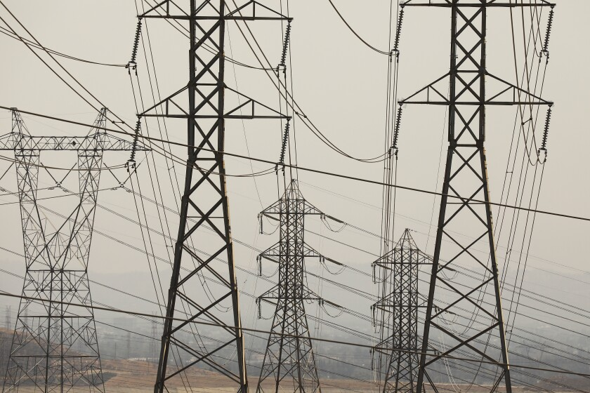 Transmission towers crisscrossed by wires.