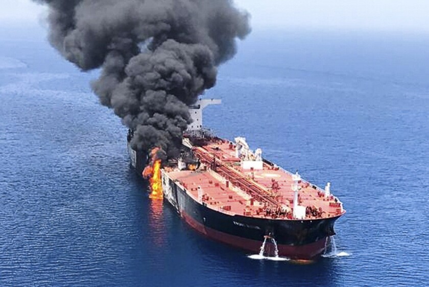 An oil tanker is on fire in the sea of Oman, Thursday, June 13, 2019. Two oil tankers near the strat