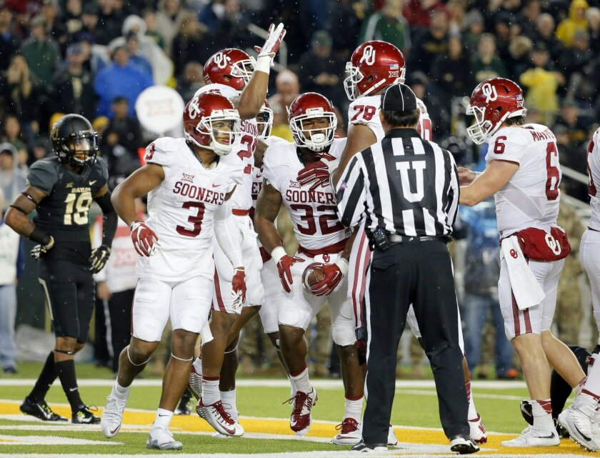 FILE - In this Saturday, Nov. 14, 2015, file photo, Oklahoma's Sterling Shepard (3), Orlando Brown (78) and Baker Mayfield (6) celebrate a touchdown scored by Samaje Perine (32) on a running play against Baylor in the first half of an NCAA college football in Waco, Texas. Oklahoma hosts TCU on Saturday, Nov. 21. (AP Photo/Tony Gutierrez, File)