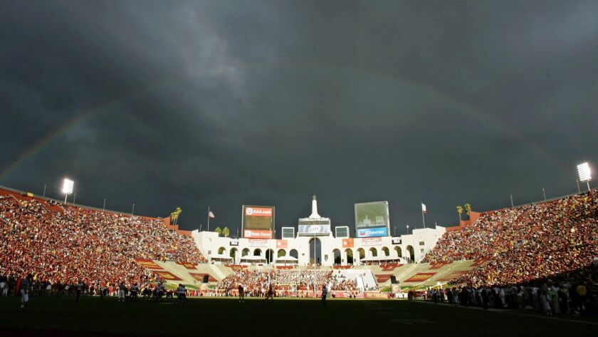 FILE - In this Sept. 22, 2007 file photo, a rainbow forms over the Los Angeles Memorial Coliseum dur