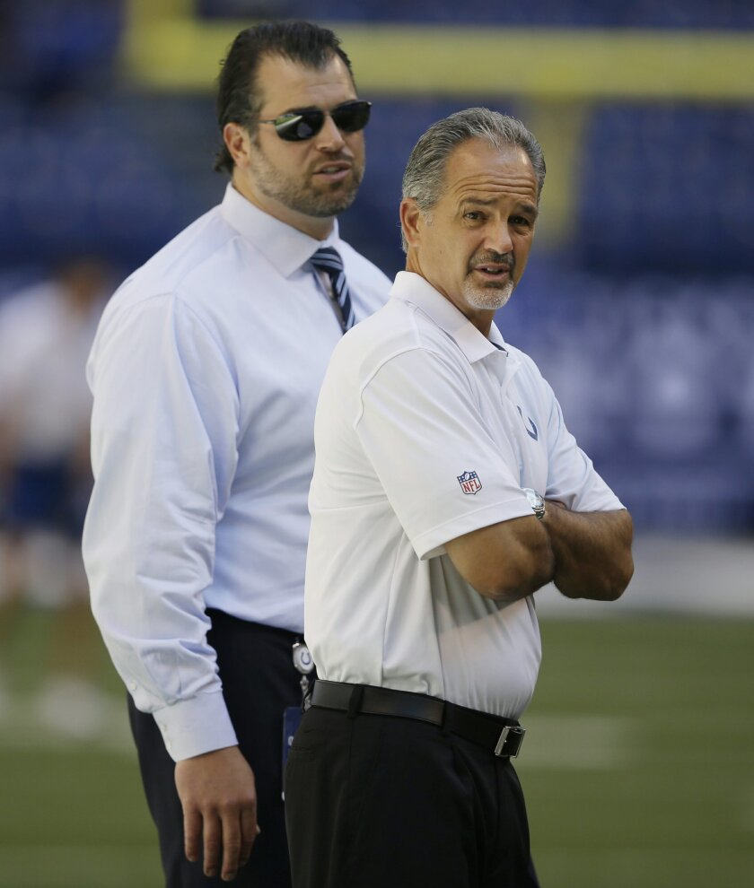 FILE - In this Sept. 28, 2014, file phot,o Indianapolis Colts general manager Ryan Grigson, left, and head coach Chuck Pagano walk on the field before an NFL football game against  the Tennessee Titans in Indianapolis. Pagano's contract is about to expire after turning down a one-year extension dur