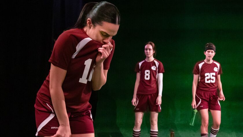 "Donna Zadeh, left, Ellen Neary and Connor Kelly-Eiding, all wearing soccer uniforms, in Echo Theater's ""The Wolves."""