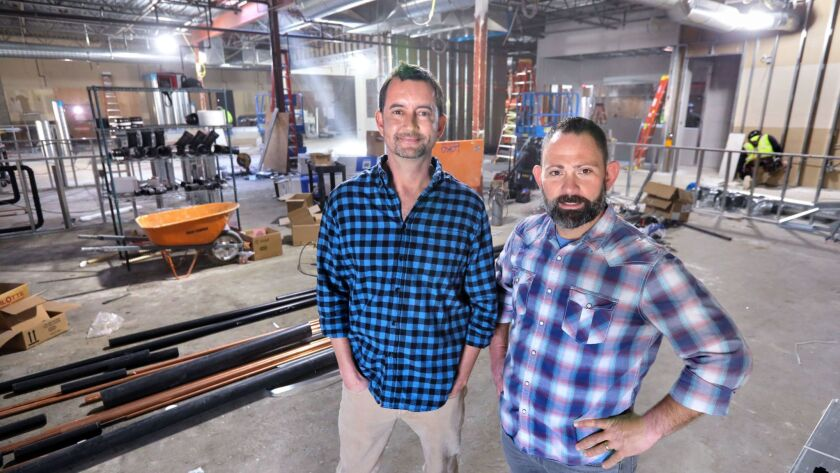 My Yard Live partners Mark McLarry, left, and Jamie Minotti stand Thursday in the former Hometown Buffet location in San Marcos during it's transformation to their new brewery, restaurant and entertainment venue scheduled for completion this summer.