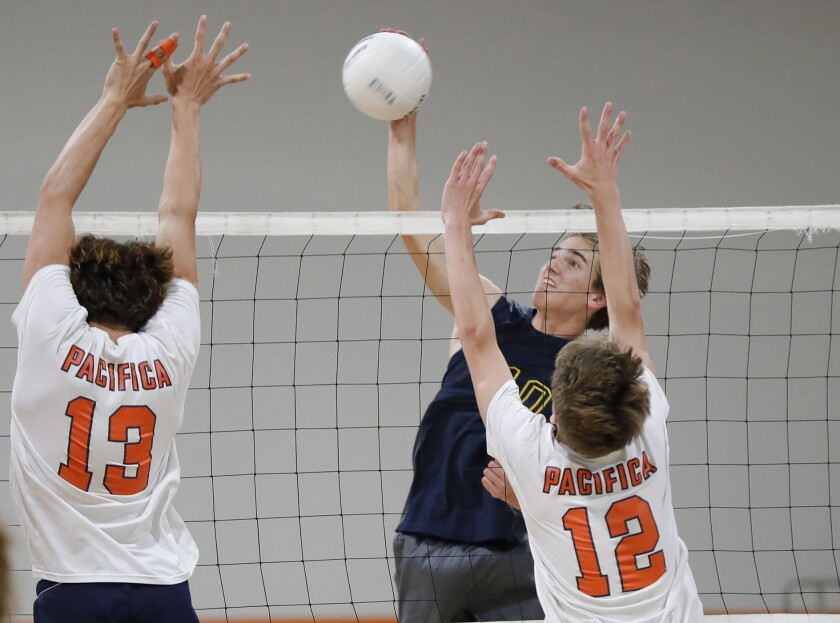 Marina's Daniel Purtell (10) kills the ball past Pacifica Christian during a CIF Southern Section Division 4 quarterfinal.