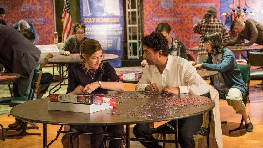 """Kelly Macdonald and Irrfan Khan star as partners in jigsaw puzzle competitions in the film """"Puzzle."""""""