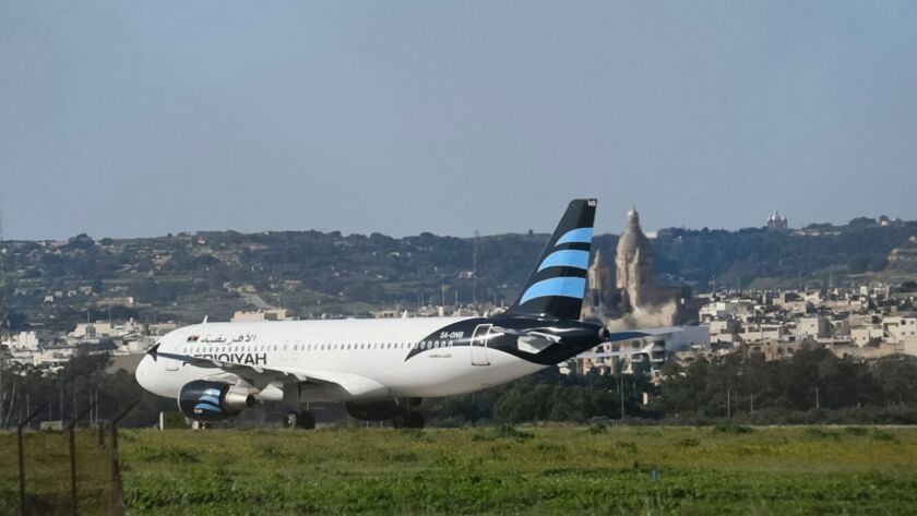 An Afriqiyah Airways plane from Libya stands on the tarmac at Malta's Luqa International airport on Dec. 23.