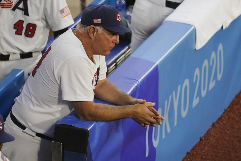 United States manager Mike Scioscia watches players warm up ahead of a semi-final baseball game against South Korea at the 2020 Summer Olympics, Thursday, Aug. 5, 2021, in Yokohama, Japan. (AP Photo/Sue Ogrocki)