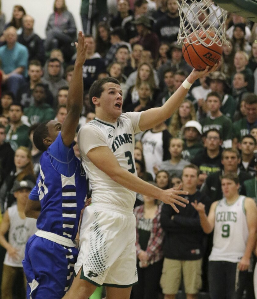 Poway High's Dalton Soffer goes in for a layup during last week's game against Rancho Bernardo at Poway High.