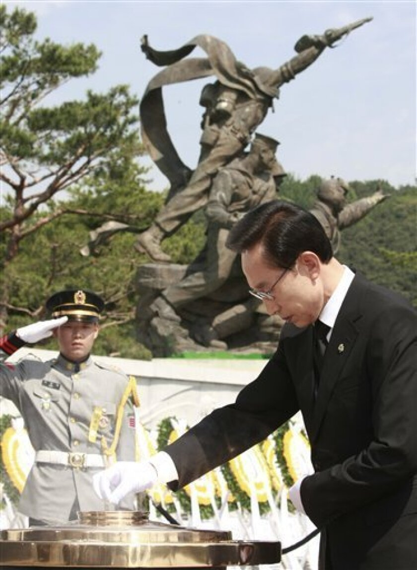 South Korean President Lee Myung-bak burns incense during a Memorial Day ceremony at the national cemetery in Seoul, South Korea, Sunday, June 6, 2010. In a televised Memorial Day speech, Lee throttled back Sunday the criticism of North Korea over the sinking of a warship and stressed the need for peace and eventual unification with the impoverished, unpredictable nuclear-armed nation.(AP Photo/Ahn Young-joon, Pool)